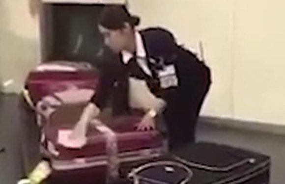 Japanese airport worker is filmed cleaning luggage before passengers pick it up