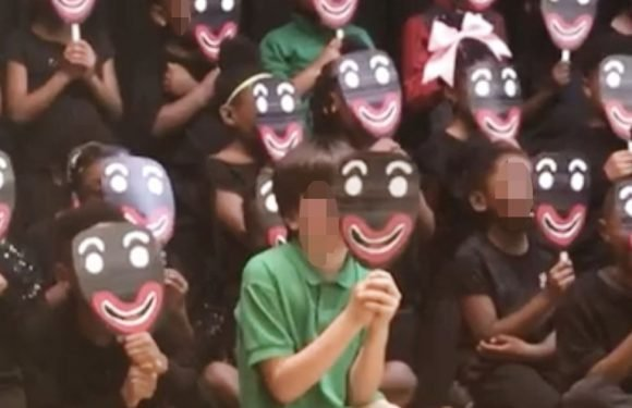Outrage as primary school-age pupils hold up blackface masks during performance