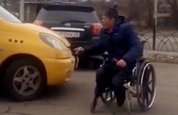 Disabled man with no feet knocked from wheelchair by taxi after violent outburst