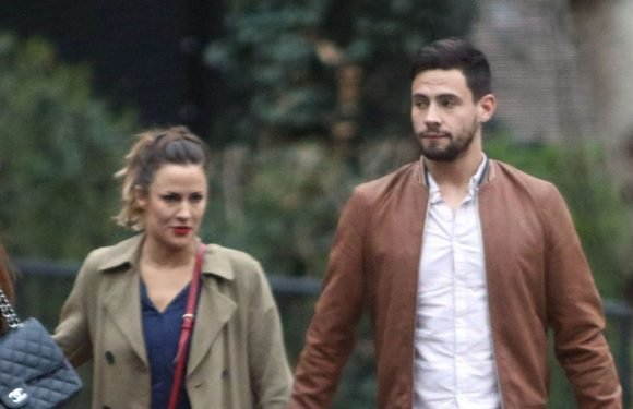 Caroline Flack grabs toyboy Andrew Brady's bum on romantic date night