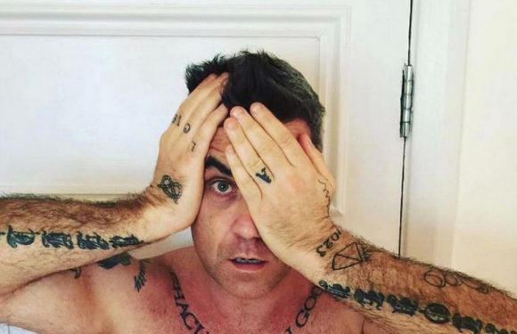 Robbie Williams blasted as a 'creepy weirdo' over huge tattoo of his own face