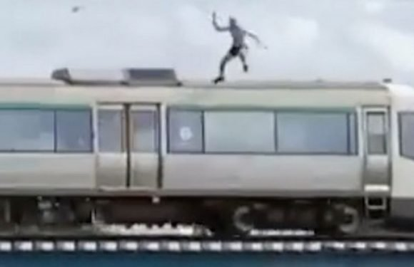 Train surfer jumps from moving train into river narrowly missing concrete strut