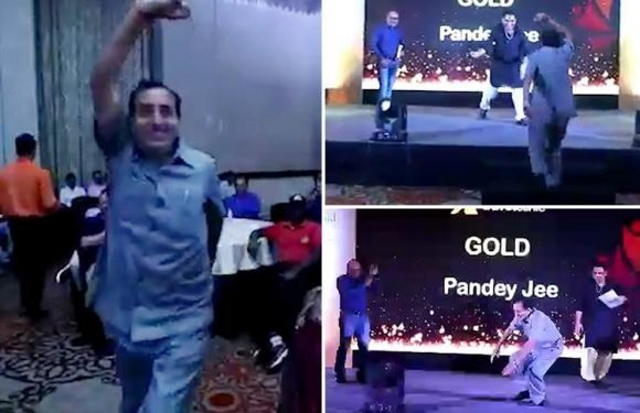 Shocking moment man drops dead at awards bash after dancing on to the stage to collect prize