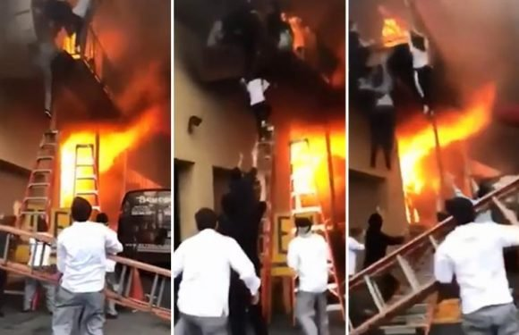 Children forced to leap from balcony to escape raging second-storey blaze as it rips through New Jersey dance studio