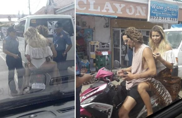 Attractive blonde tourist pulled over by cops in the Philippines for riding on a motorbike wearing skimpy bikini knickers