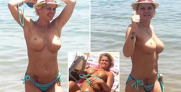 Danniella Westbrook goes topless in the sea in Spain after fleeing UK following arrest
