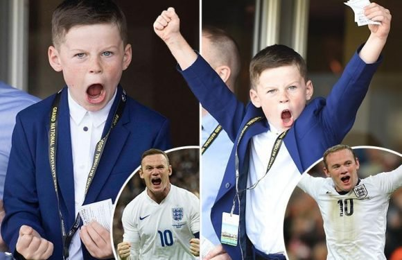 Kai Rooney pulls off dad Wayne's famous goal celebration as he watches Grand National