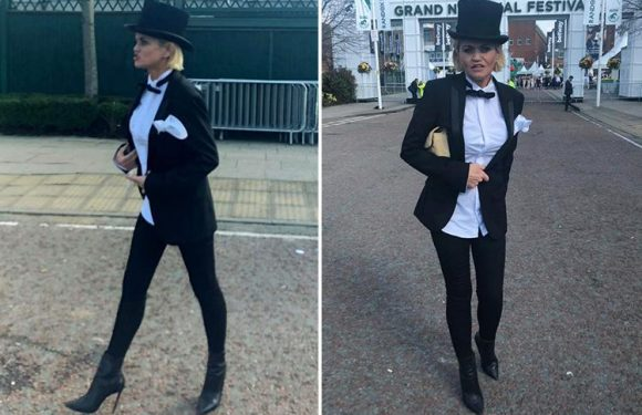 Danniella Westbrook arrives at Aintree Grand National wearing a tuxedo and top hat after arrest drama