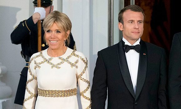France's First Lady Brigitte Macron Shines In Off-White Gown With Gold Accents At State Dinner