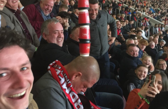 Manchester United fans stack coffee cups on head of supporter who fell asleep during West Brom defeat
