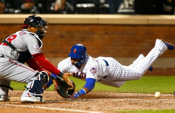 Mets explode for nine runs in 8th to avoid sweep by Nationals