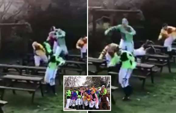 Lads dressed as jockeys hold own Grand National jumping tables in pub beer garden