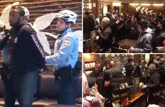Dramatic moment Starbucks cafe is shut down after protesters burst in chanting 'Starbucks coffee is anti-black!'
