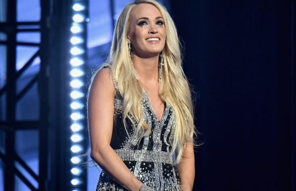 Carrie Underwood gets emotional in first performance after facial surgery