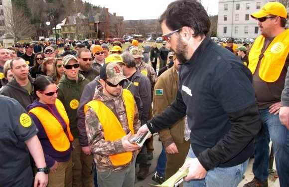 Gun rights advocates hand out free high-capacity magazines at rally