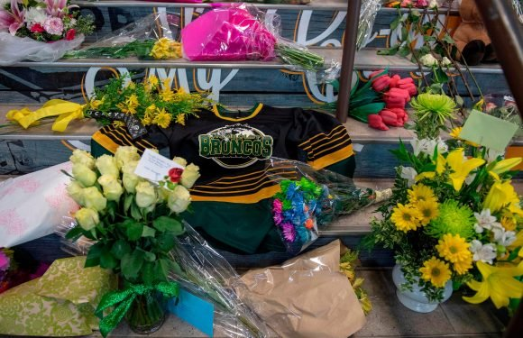Devastated tiny hockey town gathers after bus crash that tore it apart