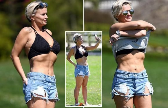 Kerry Katona strips to a bikini top for a sizzling sunbathing session in scorching spring heatwave