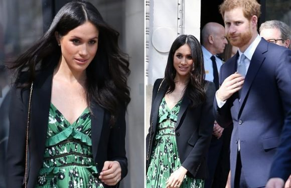 Meghan Markle looks radiant in low cut green dress as she and Prince Harry meet Aussie PM at Invictus Games reception