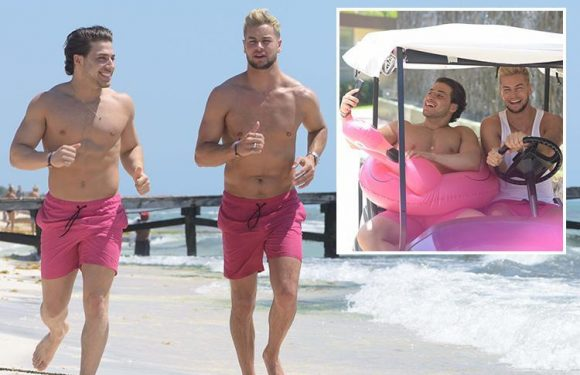 Chris Hughes and Kem Cetinay wear matching pink swim trunks as they take their bromance to Mexico