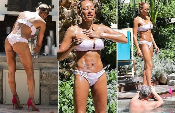 Mel B shows off her incredible toned body and flashes her bum in a thong as she relaxes by the pool in Desert Hot Springs