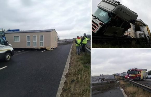 M62 crash leaves one dead and another fighting for life as lorry carrying mobile home smashes into car