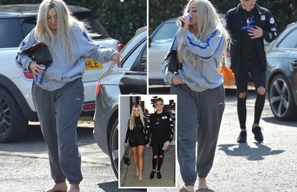 Chloe Ferry swigs from a can of beer as she walks barefoot after a heavy night with boyfriend Sam Gowland