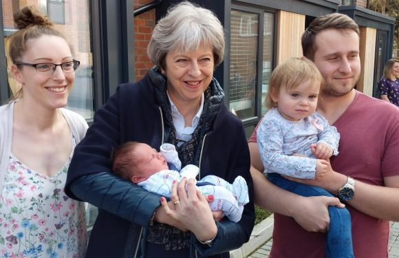 Dads need to step up and do more to care for children to tackle pay gap, Theresa May says