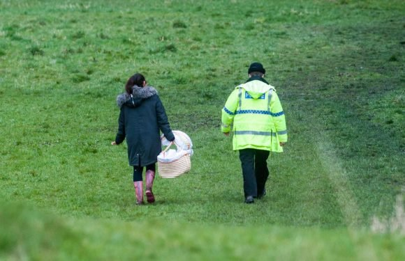 Heartbreaking moment cops carry Moses basket as they recover body of baby dumped in field