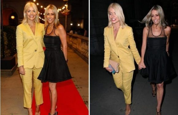 Holly Willoughby is all smiles with pal Nicole Appleton on night out in London