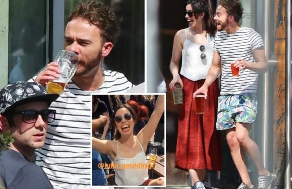 Coronation Street stars Jack P. Shepherd and Julia Goulding enjoy a liquid lunch on the hottest day of the year during a break from filming