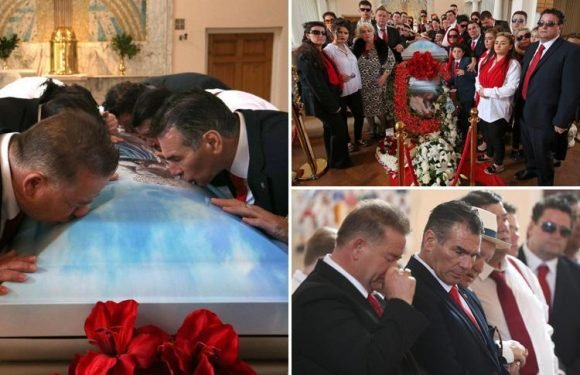 Gypsy king Paddy Doherty kisses the coffin of his beloved mum 'Queenie' after she dies of a heart attack following the passing of her husband