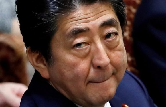 Japan PM Abe's rating falls in media poll amid scandal woes