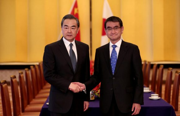 Japan and China's foreign ministers pledge to pursue improved ties