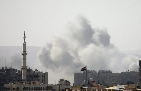 Syrian army bombards south Damascus enclave