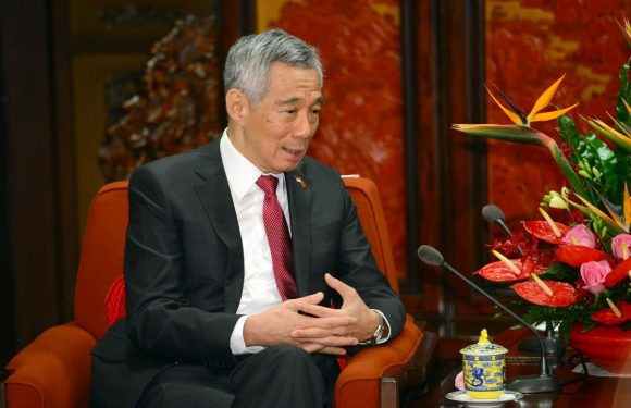 Singapore PM reshuffles cabinet with succession question looming