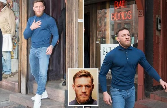 Conor McGregor walks down the street with his trademark strut after coughing up $50k bail money following coach rampage