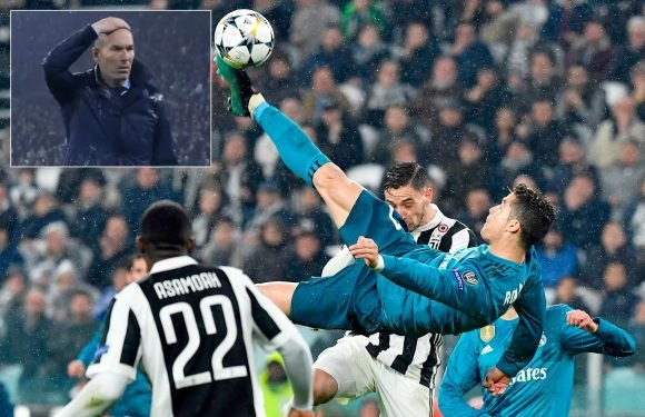 Real Madrid manager Zinedine Zidane rubs his head in disbelief as Cristiano Ronaldo scores stunning overhead kick