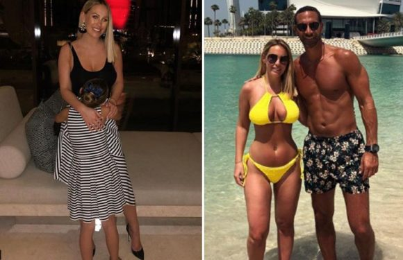 Kate Wright cuddles beau Rio Ferdinand's daughter Tia, 6, as they show off matching outfits on holiday in Dubai
