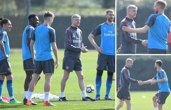 Arsene Wenger smiles with Arsenal stars as they welcome him back to training
