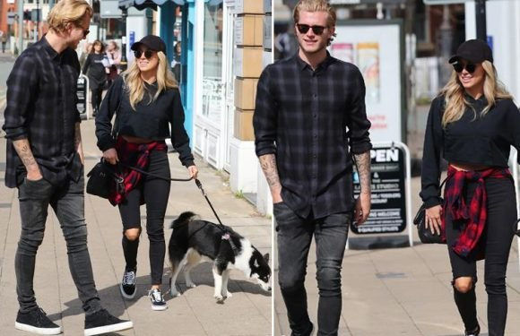Liverpool stopper Loris Karius goes for a stroll with blonde beauty Daniella Grace and her dog ahead of Champions League clash with Manchester City