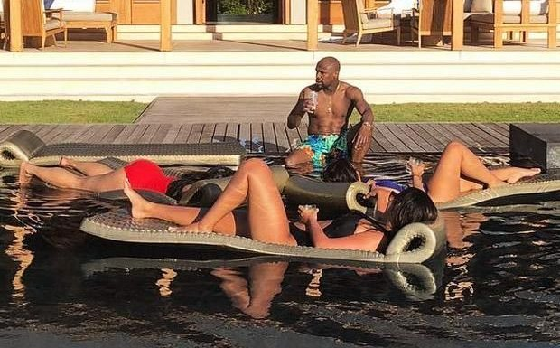 Floyd Mayweather relaxes by pool with bikini babes in Turks and Caicos as boxing legend ponders UFC career
