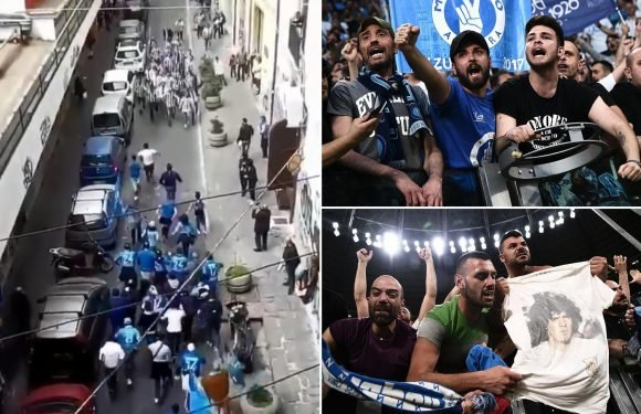 Juventus and Napoli fans embrace in touching moment despite infamous hooligan reputations as dozens of supporters wave flags and chant on narrow street