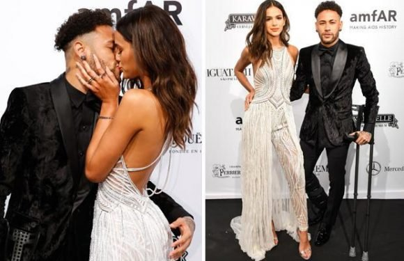 PSG ace Neymar kisses girlfriend Bruna Marquezine as he hobbles on red carpet on crutches in Sao Paulo