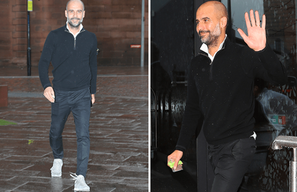 Manchester City boss Pep Guardiola arrives home from golf with a beaming smile after his side were crowned champions of England