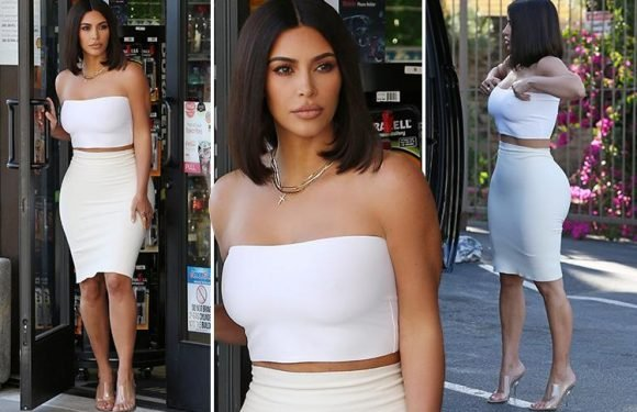 Kim Kardashian debuts new bob hairstyle as she shows off her curves in skintight white outfit
