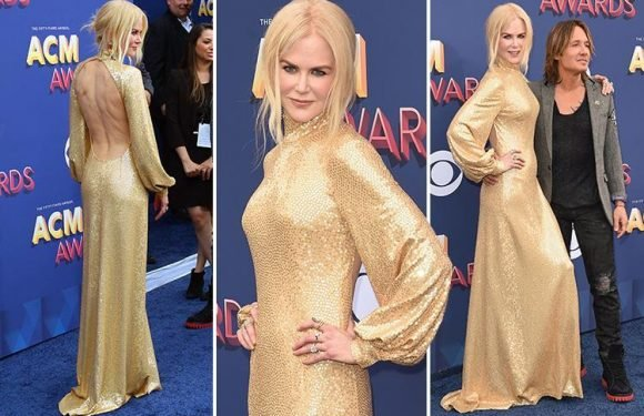 Nicole Kidman sparkles in backless gold dress at Academy of Country Music Awards with husband Keith Urban