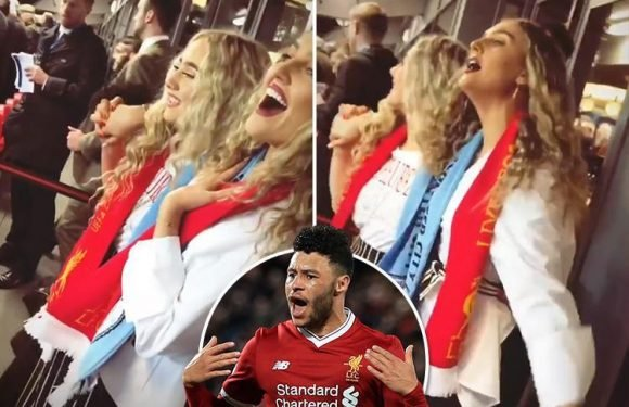 Perrie Edwards sings her heart out supporting footballer boyfriend Alex Oxlade-Chamberlain as Liverpool thrash Manchester City 3-0