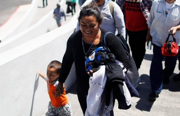 Dozens more from caravan let into US to plead for asylum