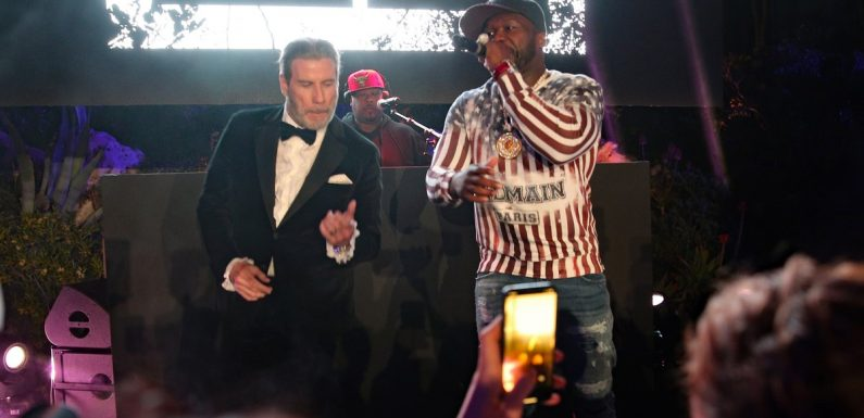 John Travolta Dancing With 50 Cent in Cannes Is the LOL Moment We Never Knew We Needed