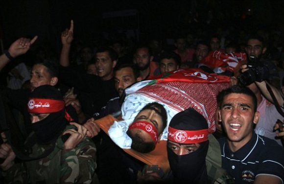 Palestinians prepare to bury their dead after day of bloody protests